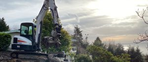 Seattle Rockeries excavator overlooking Puget Sound with dramatic clouds