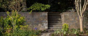 Hardscape Block Wall Landscape with lush greenery