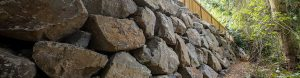 Engineered rockery wall with fence on top