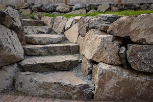 Natural stone steps embedded in scenic rockery