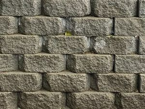 Gray cornerstone diamond face block wall
