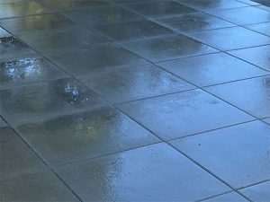 Reflections off wet Vancouver Bay pavers