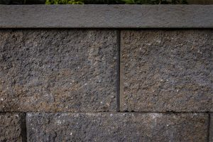 Summit Bend Manorstone block wall with gray cap
