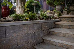 Summit blend blocks with bluestone capstones on steps leading to front garden