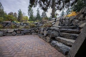 Picturesque hardscape with terraced rockery wall, natural flat steps, and pavers