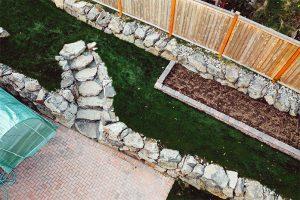 Arial view of rockery wall, rockery steps, and herringbone paver patio