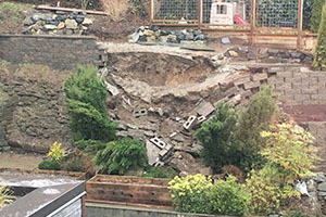 Residential landslide caused by failed retaining walls