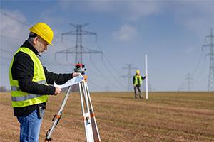 Geotechnical engineer surveying grade for land development