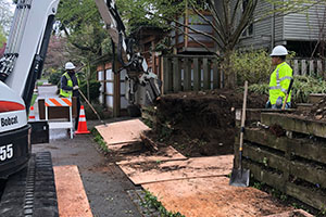 Excavation to prepare residential site for retaining wall installation
