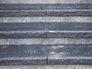 Block wall steps with onyx-colored capstones