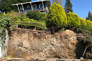 Excavated critical steep slope with home and driveway above