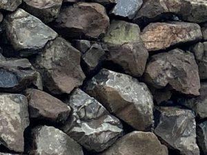 Engineered white river basalt rockery wall