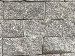 Gray cornerstone flat face block wall